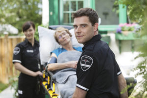emt professionals on the scene with patient