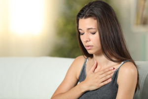 woman-experiencing-chest-pain