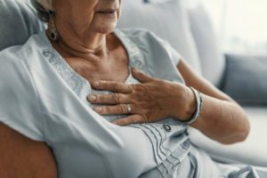 old-woman-holding-her-chest